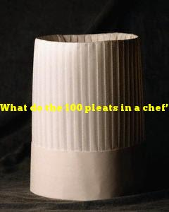 What do the 100 pleats in a chef's hat supposedly represent?